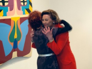 Judy Chicago embraced by the Queen of Norway at her exhibition at Oslo Kunstforening